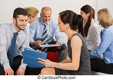 Business Colleagues Brainstorming In Groups - Business...
