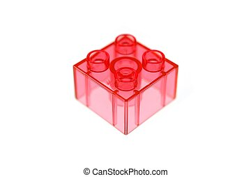 Building Block - A building block isolated against a white...