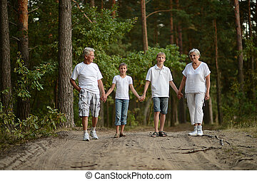 Kids with grandparents - Older man and woman walking with...