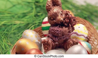 Chocolate rabbit among Easter eggs. Crane Shot