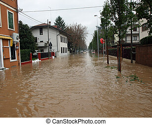 mud River invades the road completely submerged during the...