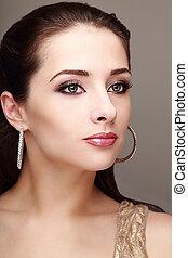 Beautiful makeup woman in fashion earring Closeup portrait