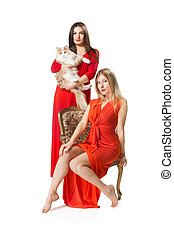 two women in long red dress on white background