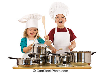 Happy kids dressed as chefs making noise with the cooking...