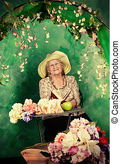 granny garden - Beautiful older woman sitting in the garden...