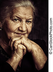 old age - Portrait of a beautiful smiling senior woman