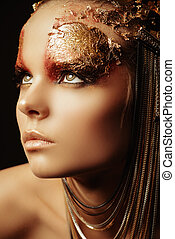 splendid - Art project: beautiful woman with golden make-up...