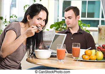 Couple eating breakfast - A shot of a couple eating their...
