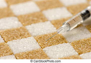Diabetes - Brown and white sugar cubes arranged checker...