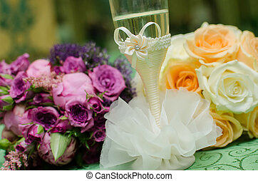 Floral arrangement and champagne glass   for table