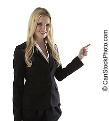 Beautiful young businesswoman pointing at white copyspace
