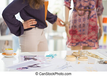 Closeup on accessories and fashion designer decorating...