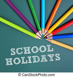 school holidays - coloured pencils of different colors and...