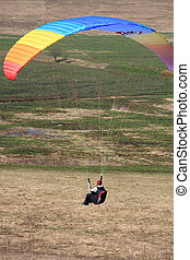 Paraglide - The glider pilot soars in a dynamic stream near...