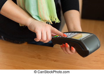 Woman pay by credit card in bookstore