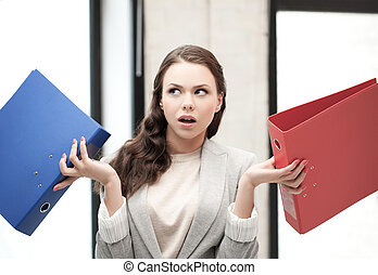 unsure thinking or wondering woman with folder - business...
