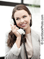 businesswoman with cell phone calling or talking