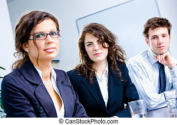 Team of business people - Businesspeople sitting in a row on...
