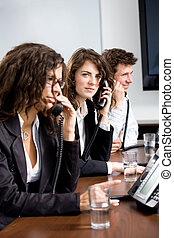 Customer service - Young customer service operator team...