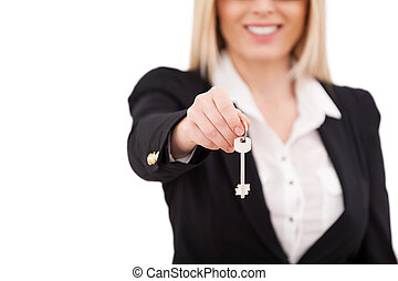 Here is your key! Cropped image of mature businesswoman...