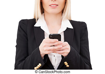 Businesswoman typing a message Cropped image of mature...