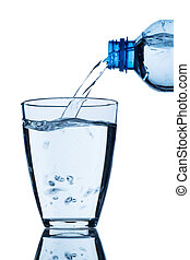 pour water into a glass - from a bottle of water being...