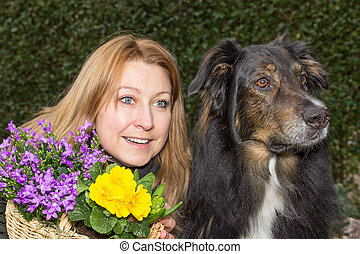 Female with flower basket and dog