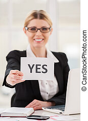 Saying yes to you. Cheerful mature woman in formalwear...