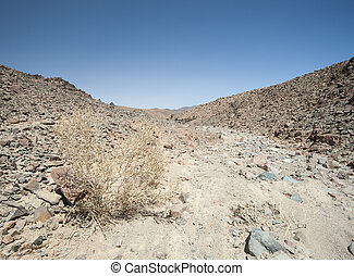 Rocky mountain slope in a desert - Rocky mountain slope...