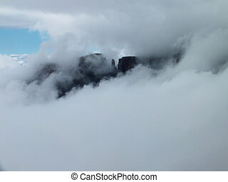 Eastern Buttress appearing through the clouds - The Eastern...