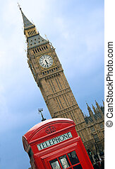 Big Ben and telephone cabin in London over blue sky
