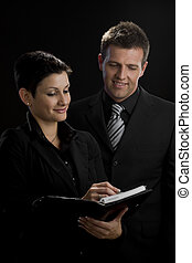 Business executives smiling - Satisfied business executives...