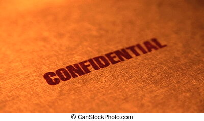 Confidential stamp on a manila folder