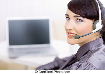 Female operator talking on headset - Happy young female...