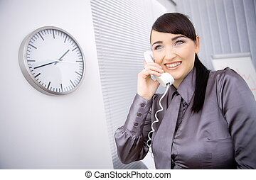 Businesswoman talking on phone - Young businesswoman wearing...