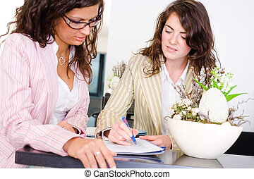 Teamwork at office - Casual businesswomen working together...
