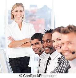 Business team smiling and being happy at work