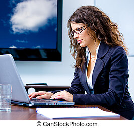 Businesswoman working on computer - Happy young...