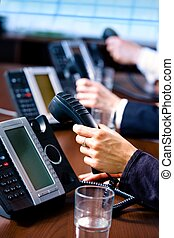 Hands holding phones - Close-up of hands holding landline...