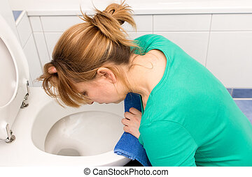 Nausea - Woman vomits in to the toilet