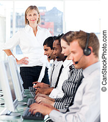 Team working in a call centre - Young Team working in a call...