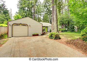 Countryside house. Garage with driveway