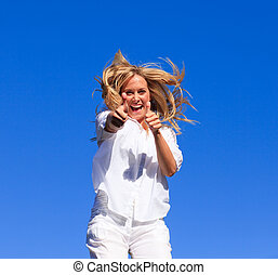 Woman Jumping in the air - Yound attractive Woman Jumping in...