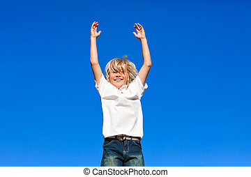 boy Jumping in the air - Young kid Jumping in the air