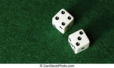 Stop Motion Dice - Stop motion dice rolling on green...