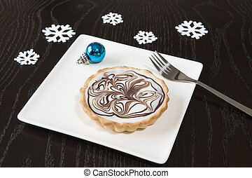 Winter Decadence - Decadent white chocolate tart on a white...