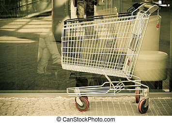 Empty shopping cart trolley outdoor. Market shop and retail....