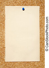 A old brown piece of paper pinned to a cork niticeboard.