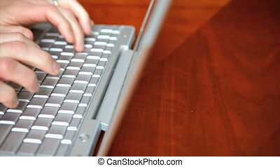 Man typing on laptop computer - Man 43 yr typing on a laptop...