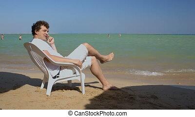 Phone talk on the beach